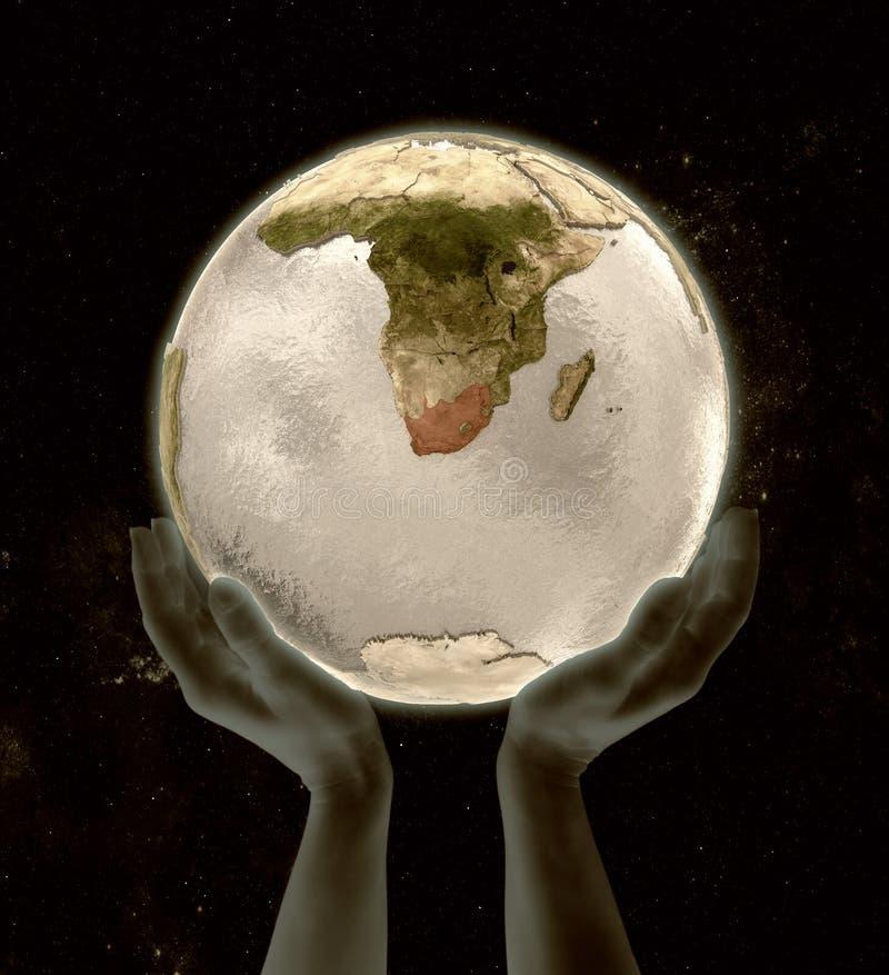 在地球胜利手上的南非 向量例证
