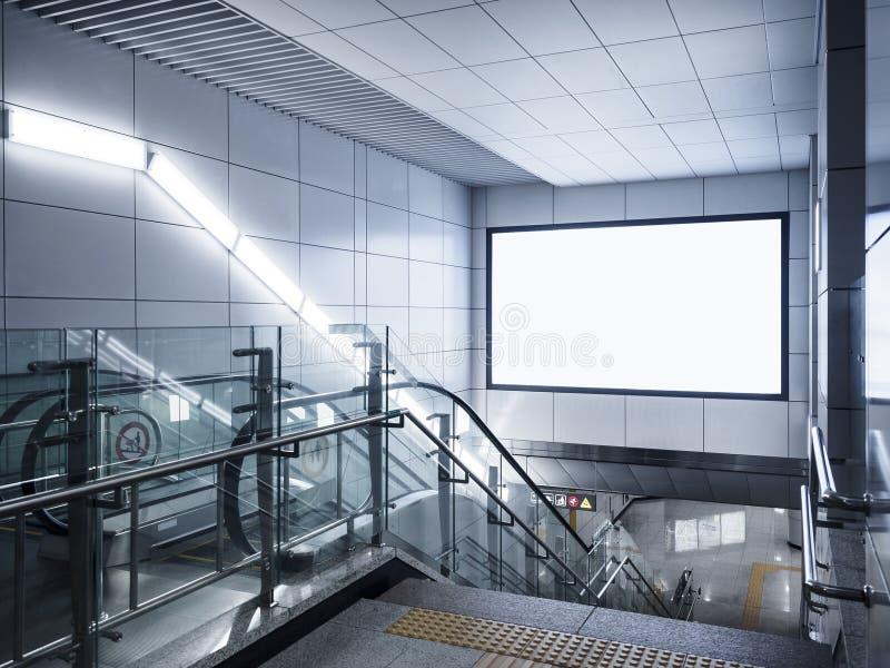在地铁的广告牌横幅标志嘲笑显示有自动扶梯的 免版税库存照片