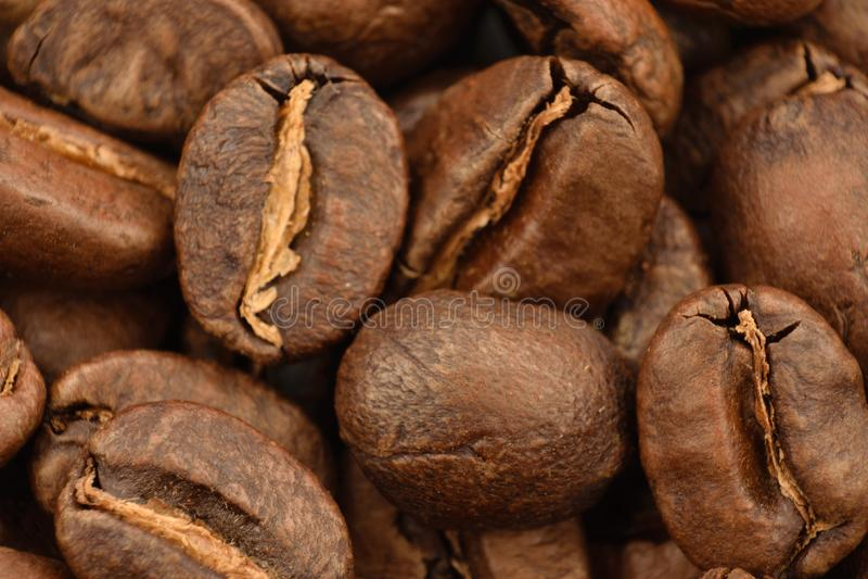 在地面coffe boakground的Coffe五谷  库存照片