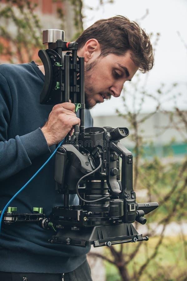 在场面之后 摄影师射击与他的照相机的影片场面 库存照片