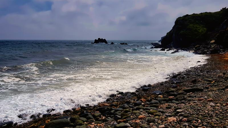 在坚固性康沃尔海岸的木瓦海滩 免版税库存照片