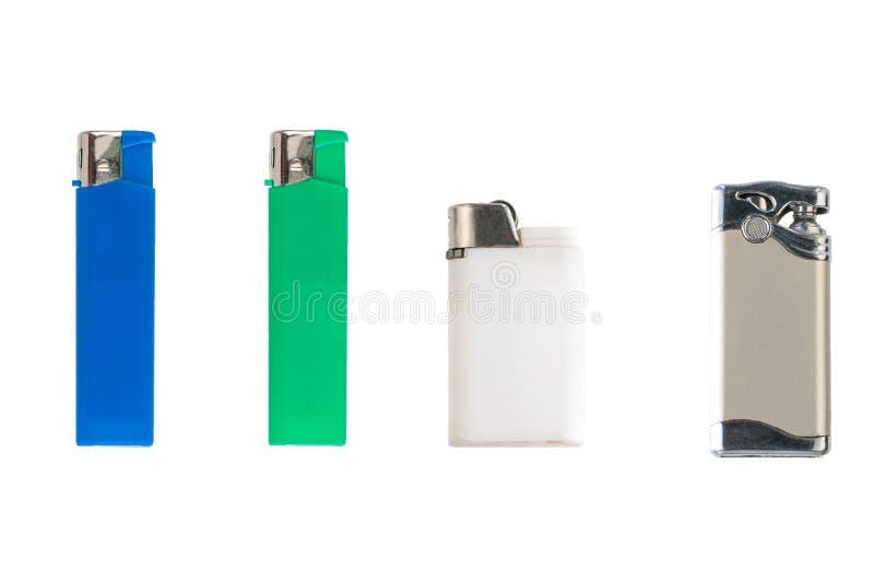 在垂直位置的另外五颜六色的香烟打火机被隔绝的在白色背景 免版税图库摄影