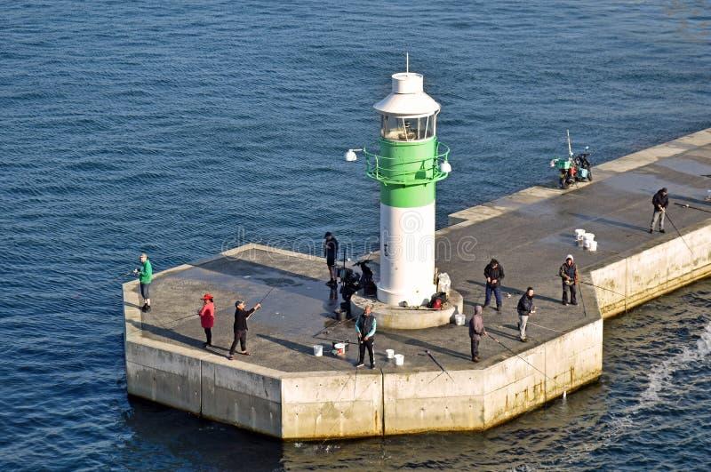 在城市奥尔胡斯的码头的灯塔在丹麦 免版税图库摄影