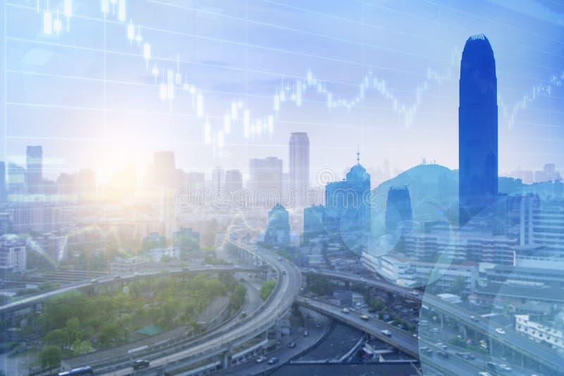 在城市背景多重曝光的事务在蓝色口气 库存图片