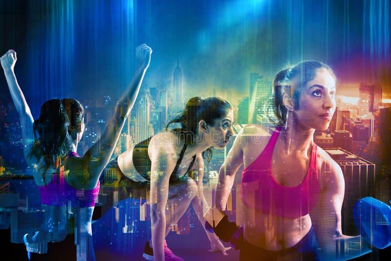 在城市背景的运动妇女锻炼 库存图片