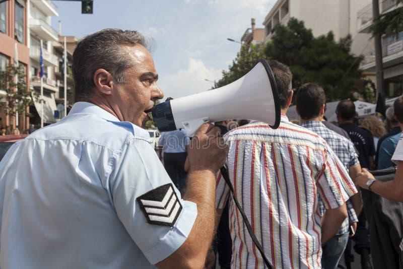 在城市街道的未认出的示威者 免版税库存照片