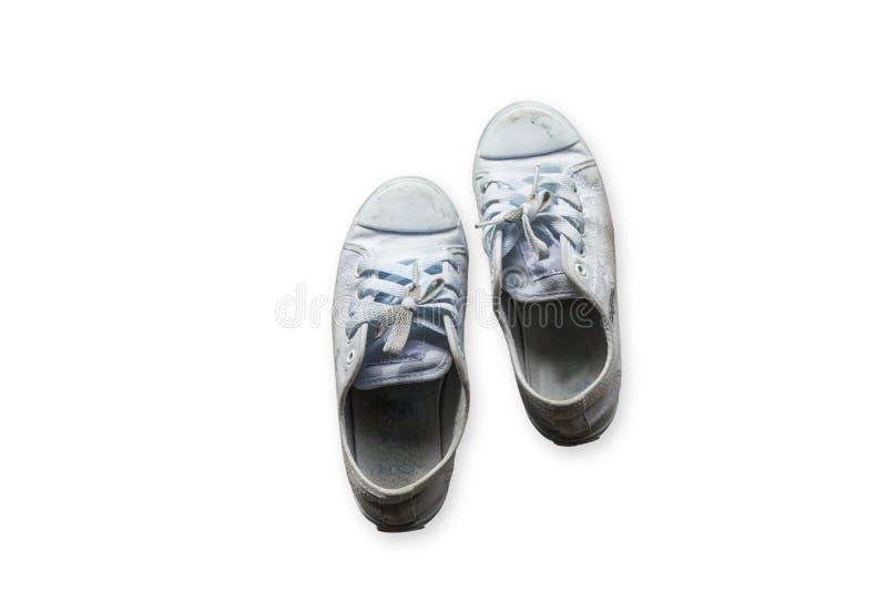 在基本上混凝土的老运动鞋 库存图片