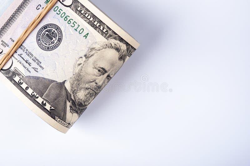 在堆的五十美金与rubberband 免版税库存照片
