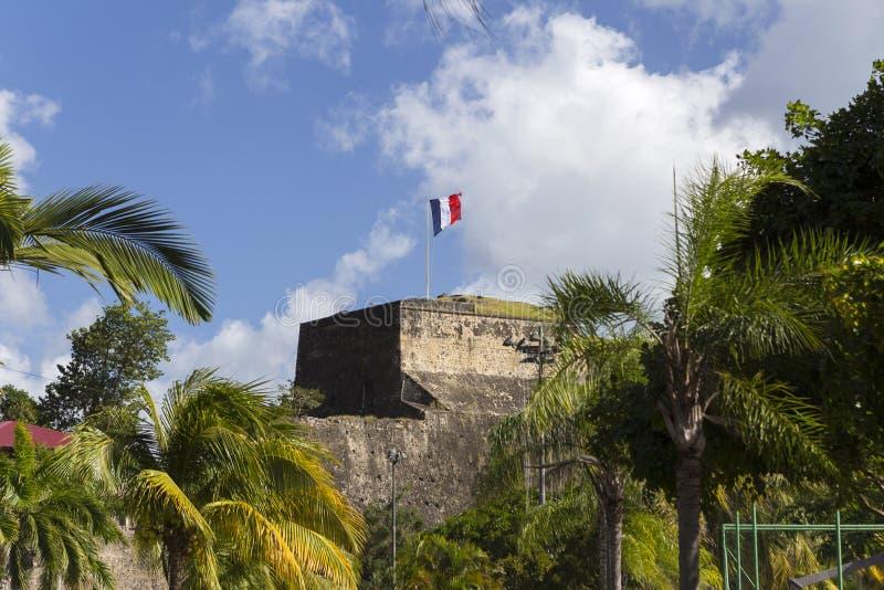 在堡垒圣路易上面的旗子在堡垒de法国,马提尼克岛 免版税库存图片