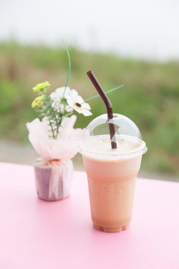 在塑料杯子的咖啡 库存照片