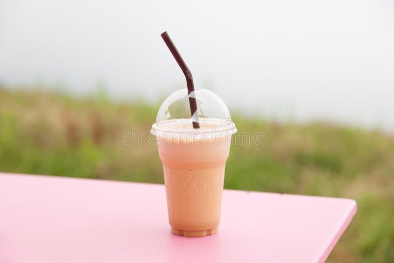 在塑料杯子的咖啡 库存图片