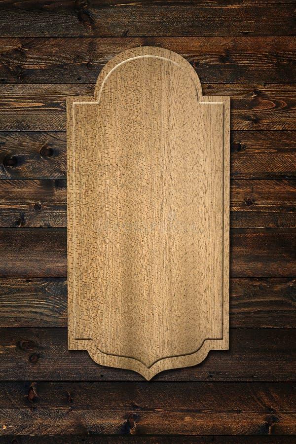 在墙壁上的一块木匾 免版税库存图片