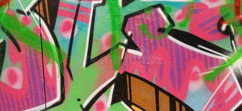 在墙壁上的五颜六色的街道画绘画,街道艺术横幅背景 免版税库存照片