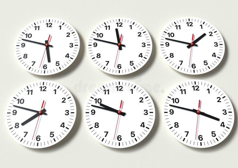 在墙壁上的六个模式时钟,显示世界时间 库存图片