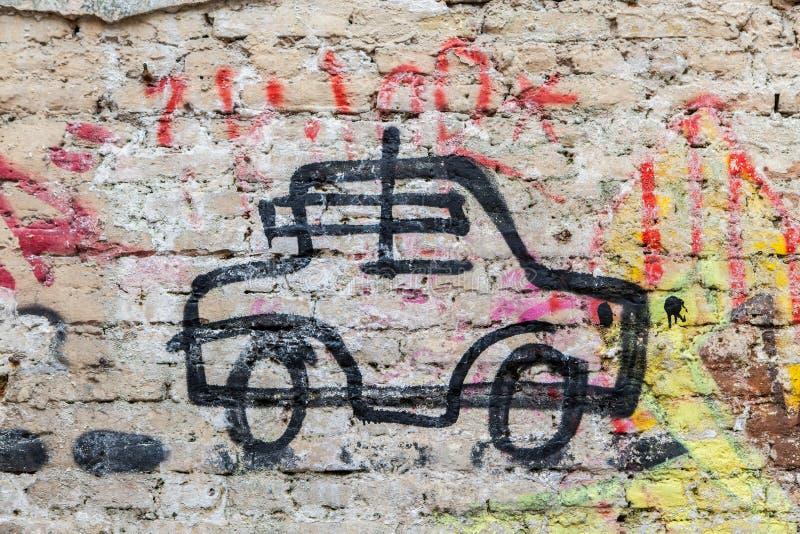 在墙壁上的汽车街道画 免版税库存照片