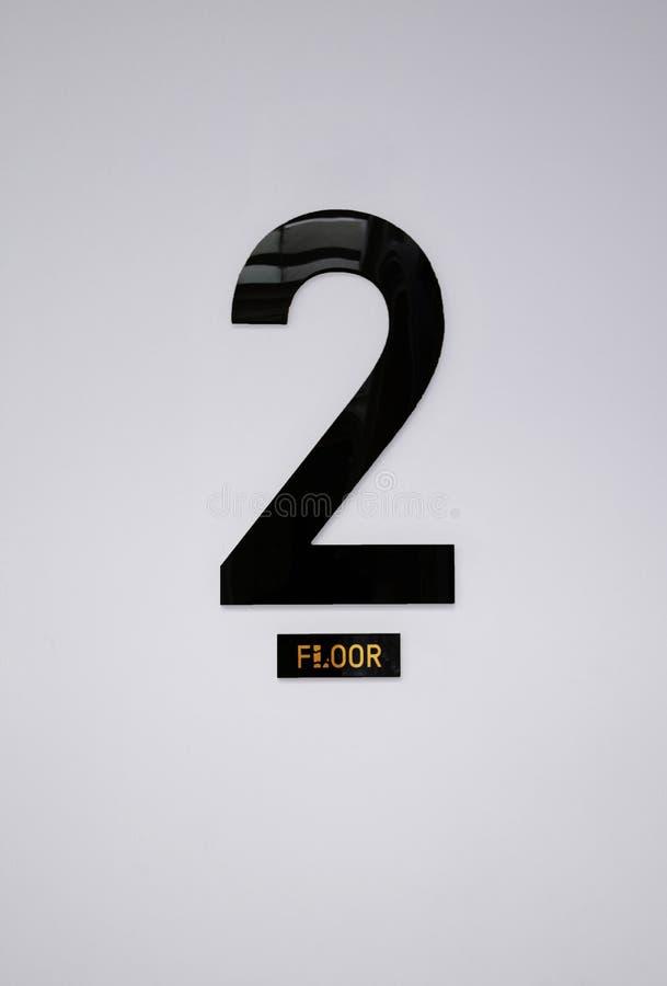 在墙壁上的第2个楼标志,地板信息 库存照片