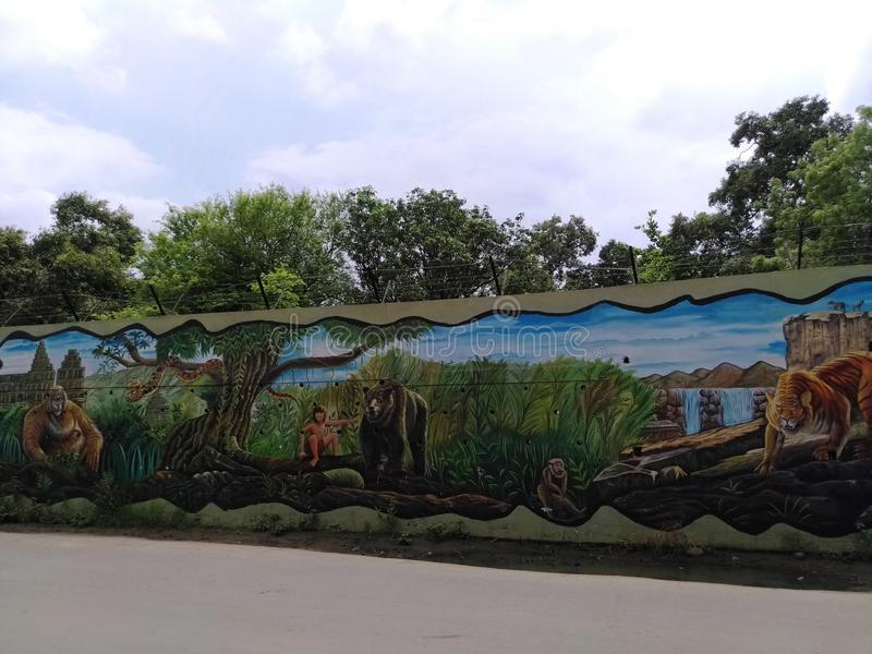 在墙壁上的绘画由一位地方艺术家 库存例证