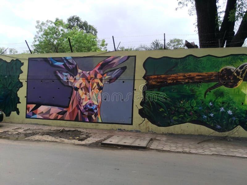 在墙壁上的绘画由一位地方艺术家 库存照片