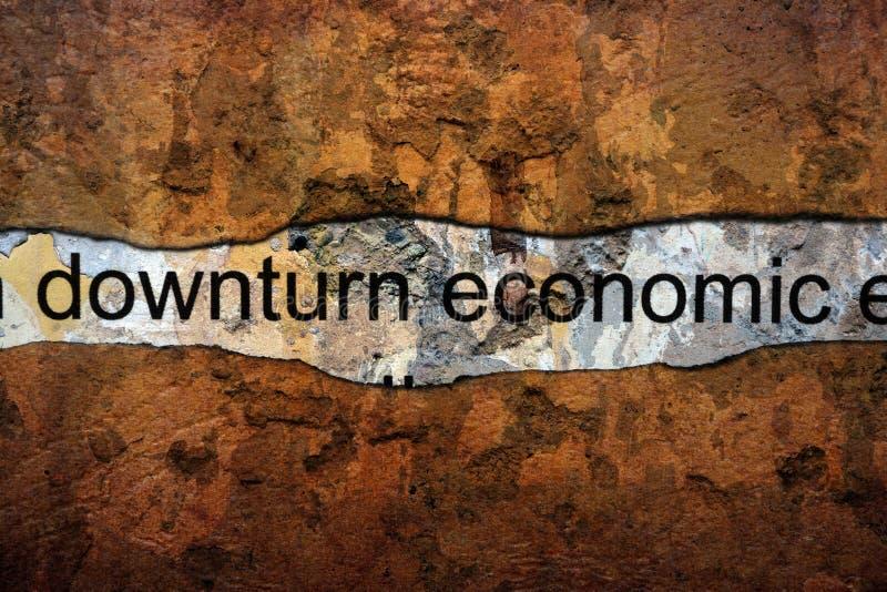 在墙壁上的转淡经济文本 免版税库存照片