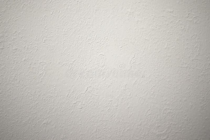 在墙壁上的轻的织地不很细膏药是不同的 在墙壁上的纹理是粗砺的没有缝装饰 免版税库存照片