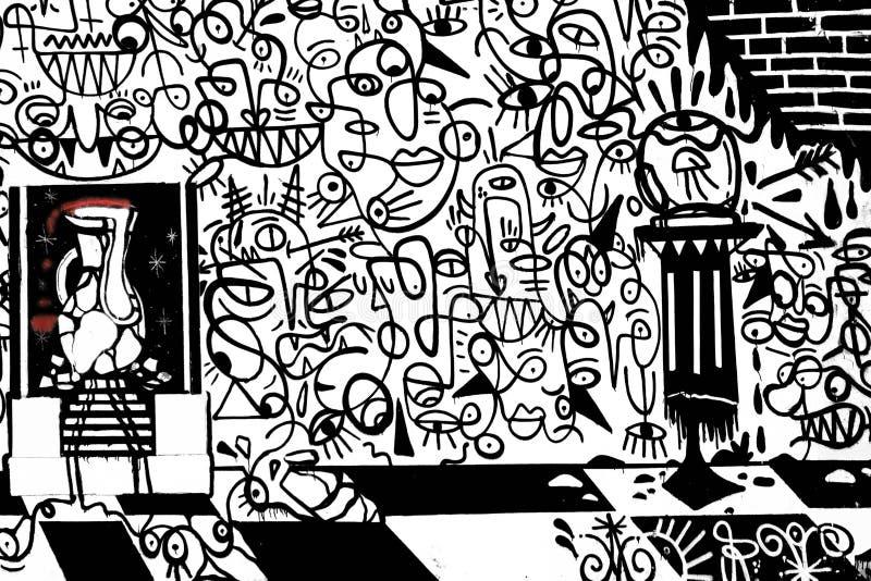 在墙壁上的黑白样式街道画 图库摄影