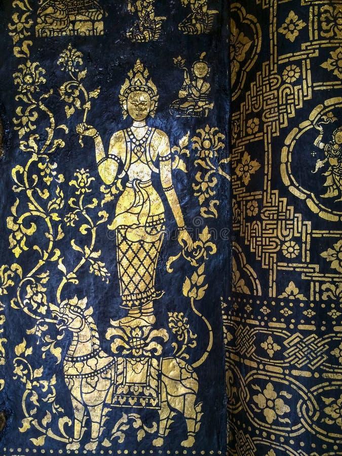 在墙壁上的绘画在佛教寺庙 免版税库存图片