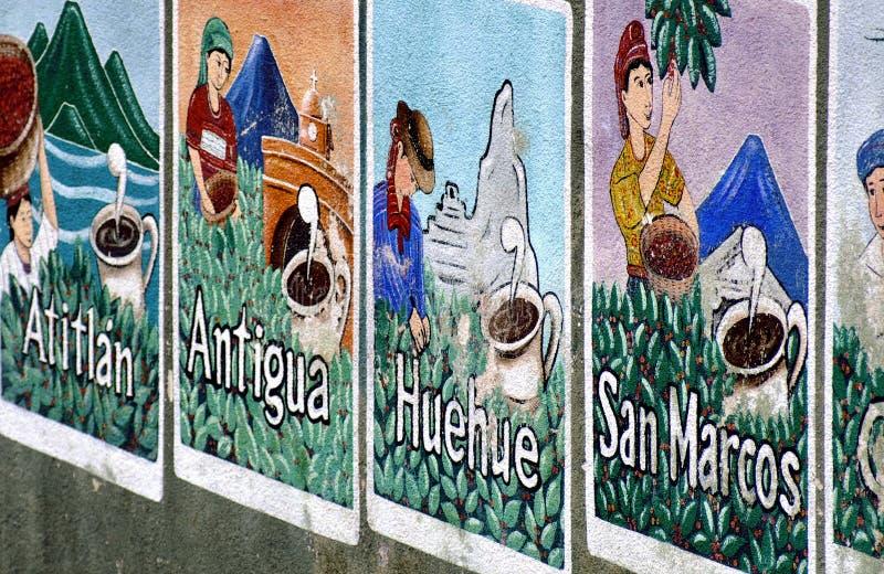 在墙壁上绘的咖啡海报在湖Atitlan,危地马拉地区 库存照片