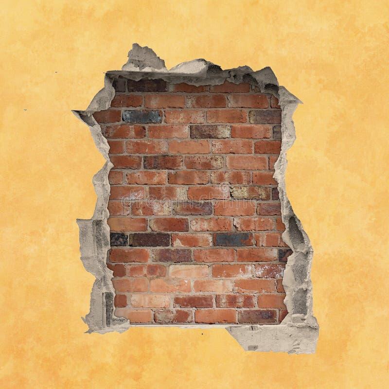在墙壁的孔 图库摄影