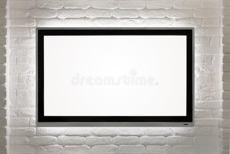 在墙壁的空白的HD电视 库存图片