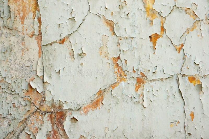 在墙壁纹理的老削皮油漆 免版税库存图片