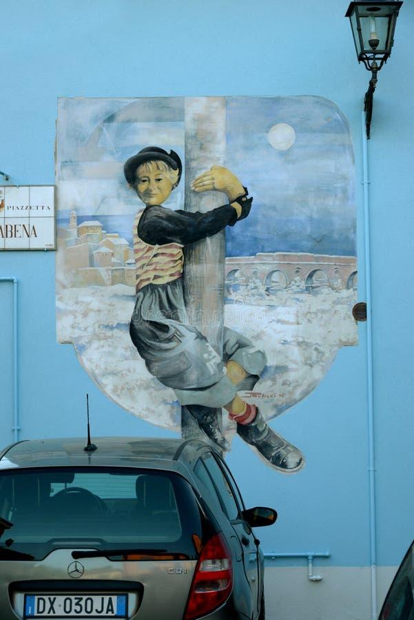 在墙壁从费德里柯・费里尼影片,意大利上的街道画 图库摄影