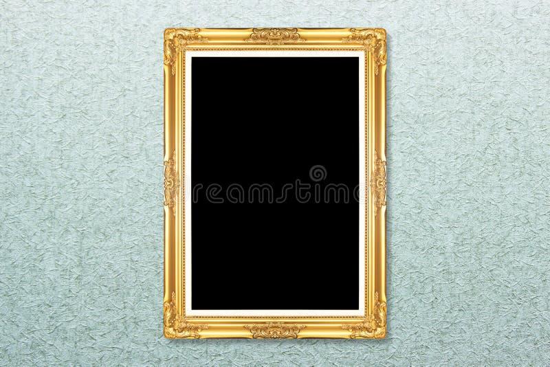 在墙纸的空的金黄葡萄酒框架 库存图片