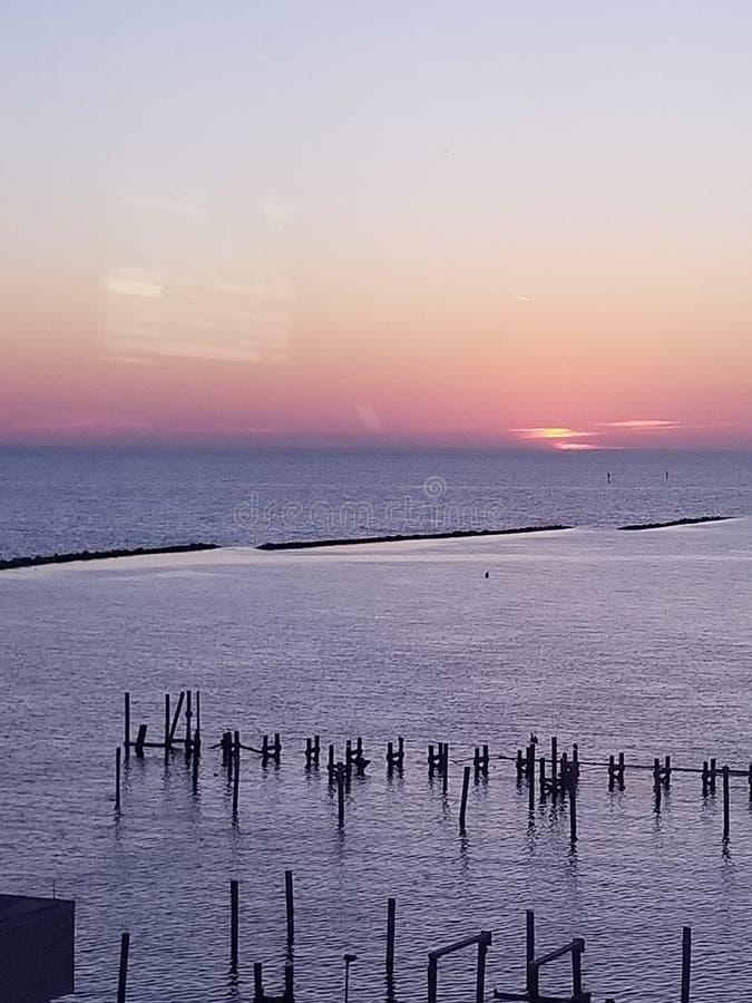在墨西哥湾的美好的日落设置 库存图片