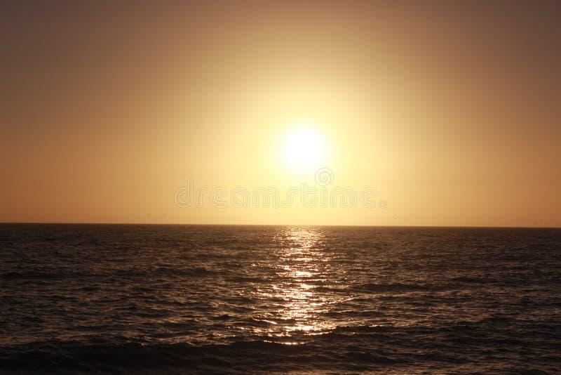在墨西哥湾的镇定的日落 免版税库存图片