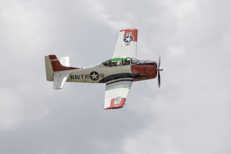 在多云天空的海军飞机 库存图片