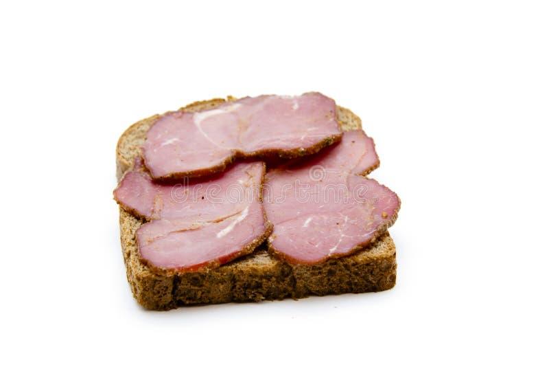 在多士面包的牛火腿 免版税库存图片
