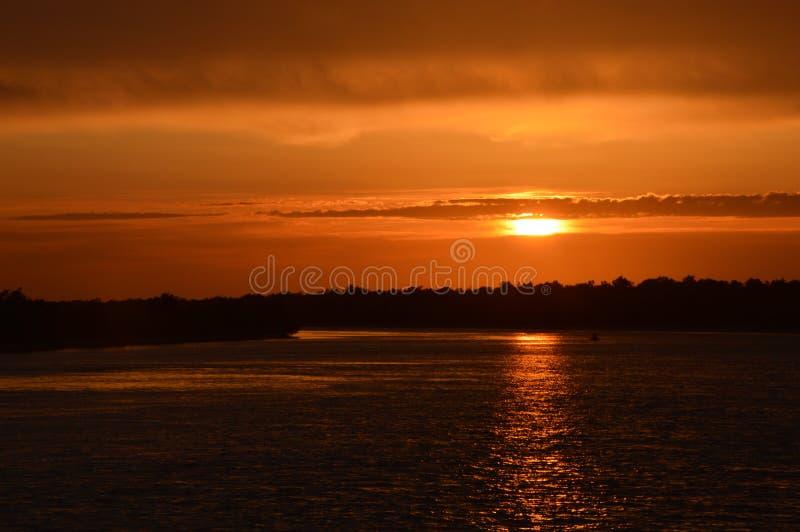在多瑙河三角洲的日落 免版税库存照片