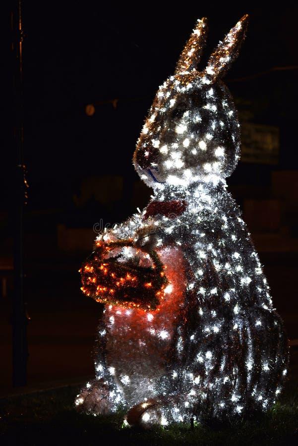 在夜光的兔宝宝复活节 免版税图库摄影