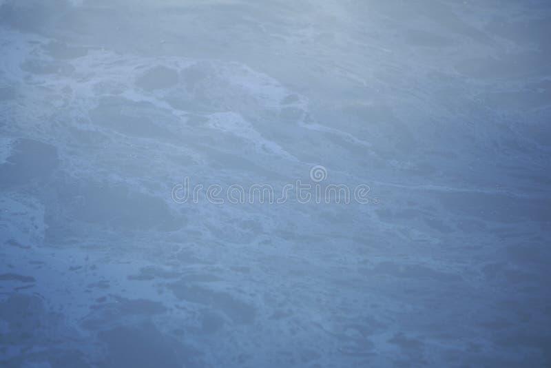 在大海圈子的油 免版税图库摄影
