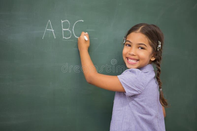 在大黑板的学生文字 库存图片