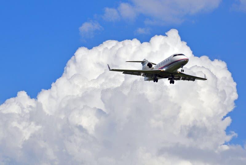 在天空的企业喷气机 库存照片