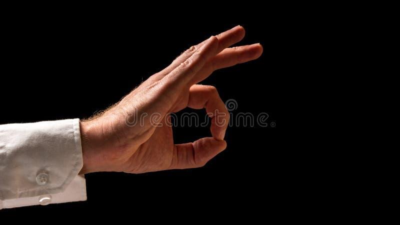 在好手标志的人的手 免版税库存图片