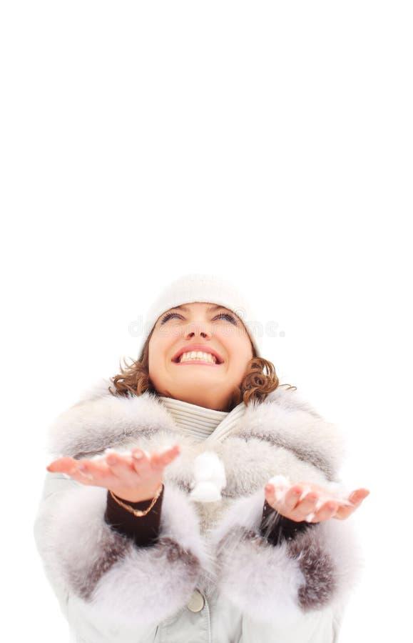 在妇女年轻人之下的雪 免版税库存图片
