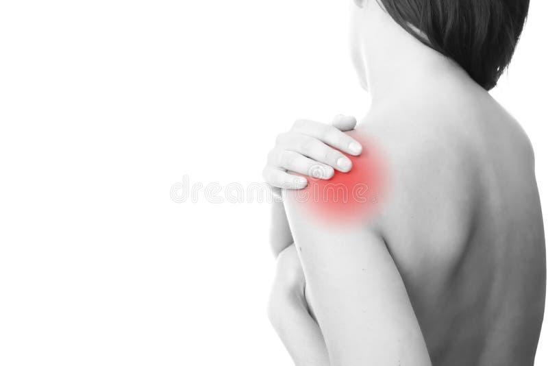 在妇女的肩膀的痛苦 免版税库存图片