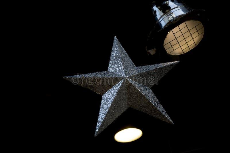 在它附近的银色星和阶段光 免版税库存照片