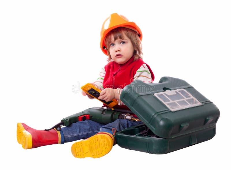 在安全帽的婴孩建造者有钻子和工具箱的 免版税图库摄影