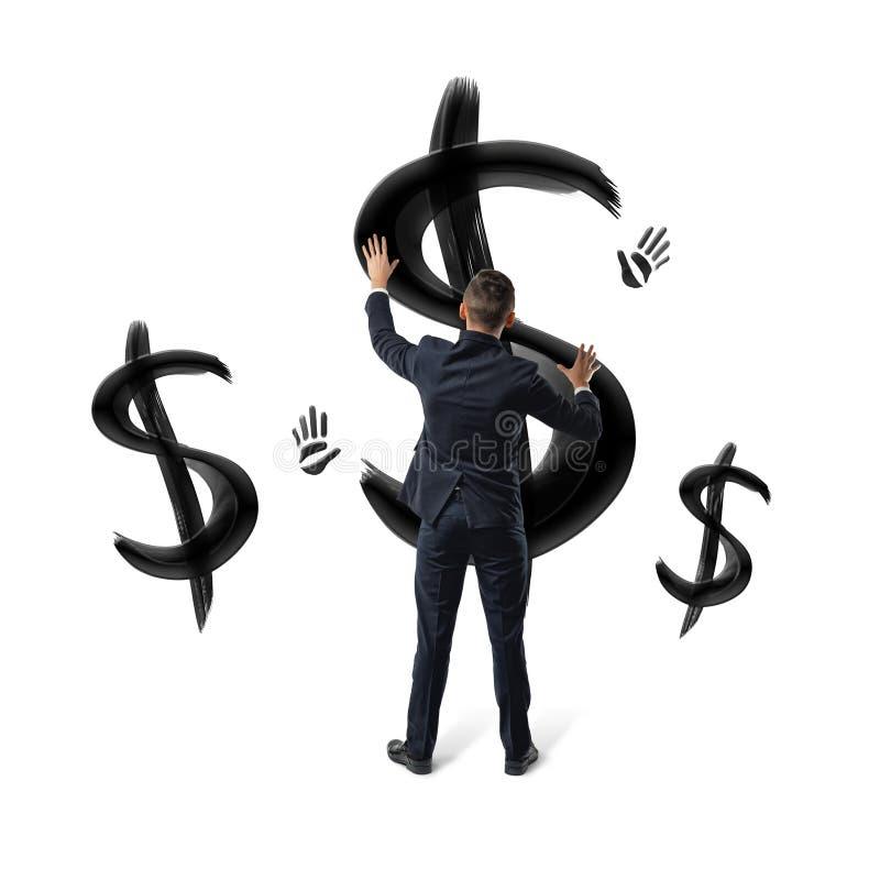 在安置手的白色背景的商人在黑色绘了美元的符号和手印刷品 库存图片