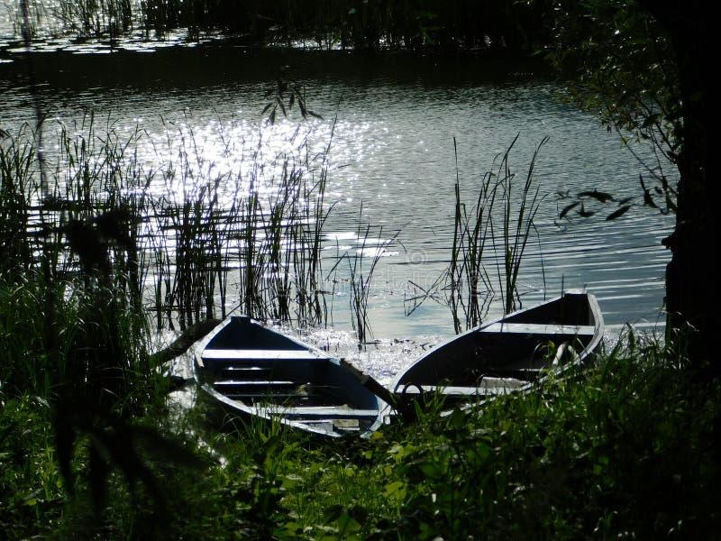 在安静的回流的两条小船 库存照片