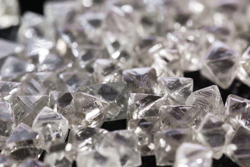 在宏指令的自然透明金刚石在黑背景 免版税库存图片
