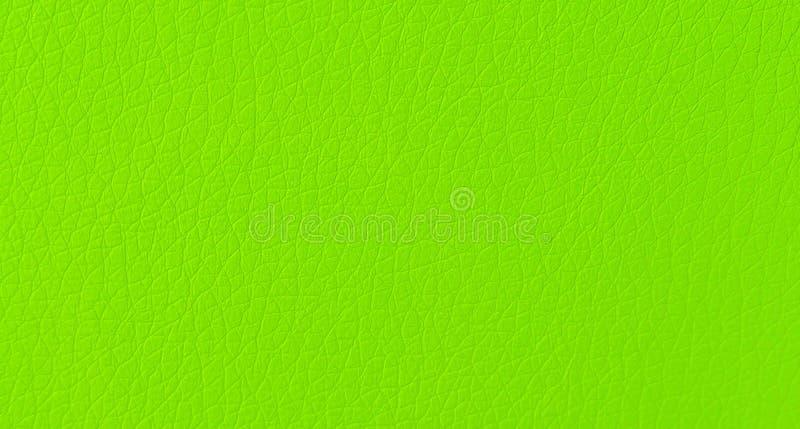 在宏观关闭的现代绿色假皮革皮肤样式纹理背景 免版税库存图片